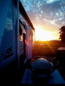 webber BBQ by caravan at sunset