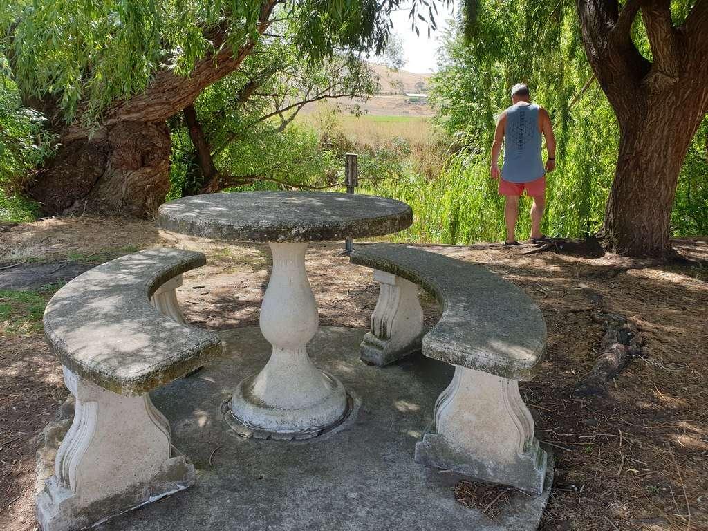 Hamilton Campground Tasmania seating man and river