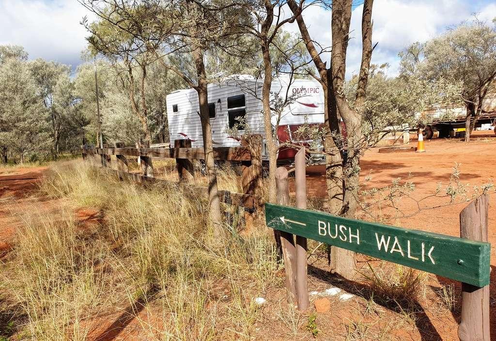 Bush walk sign and caravan at caravan park
